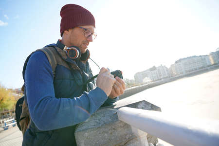 30 years old man: Hipster man taking pictures by the sea