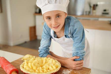 Portrait of school girl in pastry class