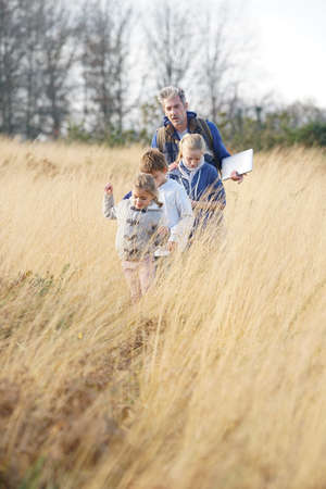 Teacher taking kids to countryside to explore nature