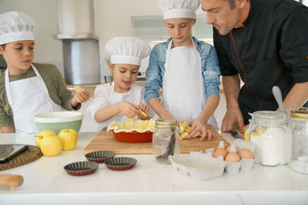 Pastry class with kids little chefs Фото со стока - 69533955