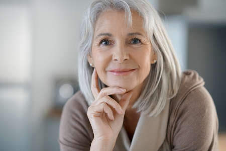 Portrait of beautiful senior woman with white hair