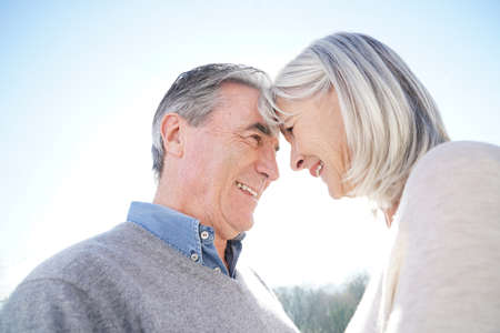 couples hug: Portrait of senior couple embracing each other