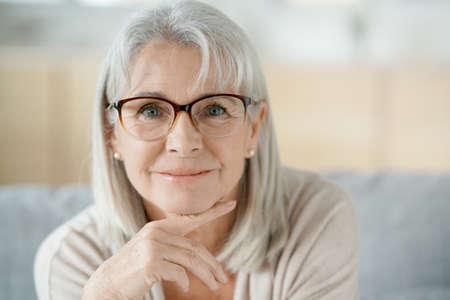 Portrait of senior woman with eyeglasses Stock Photo