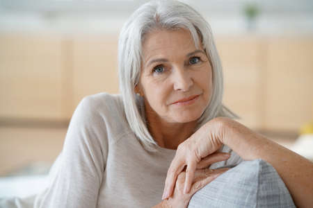 Portrait of senior woman relaxing in sofa Stock Photo