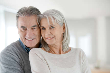 Portrait of senior couple at home Stock Photo