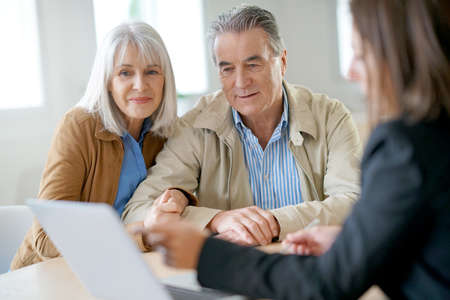 Senior couple meeting financial adviser for investment 스톡 콘텐츠