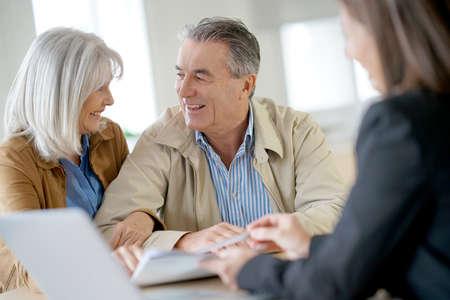 Senior couple meeting financial adviser for investment 写真素材