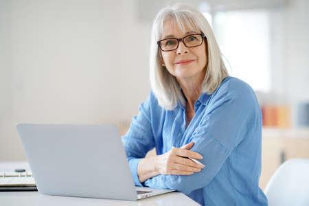 Senior businesswoman working in office