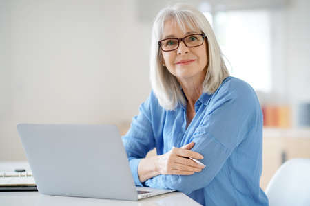 Senior businesswoman working in office