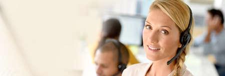 servicio al cliente: Closeup of customer service manager standing in call center