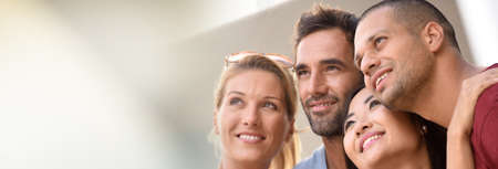 realestate: Group of young couples looking up, template