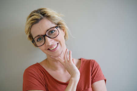 red shirt: Smiling blond woman with eyeglasses and red shirt,  isolated