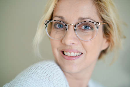 Potrait of beautiful blond woman with eyeglasses, isolated