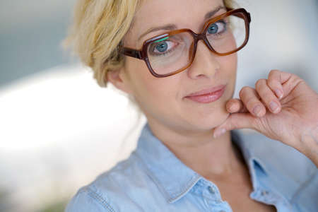 Portrait of blond middle-aged woman wearing eyeglasses Stock Photo