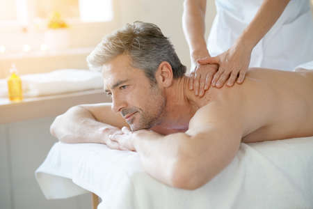 massage table: Man relaxing on massage table receiving massage