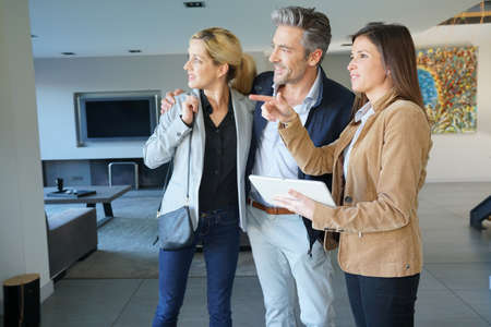 Couple visiting home with real-estate agent