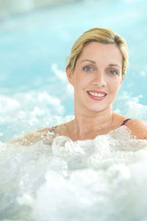 thalasso: Middle-aged woman enjoying thermal bath in thalassotherapy center