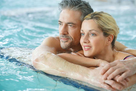 thalasso: Couple relaxing in thalassotherapy thermal water Stock Photo