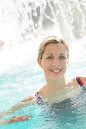 Attractive blond woman relaxing in spa pool