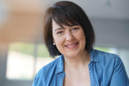 Portrait of smiling 50-year-old woman Standard-Bild