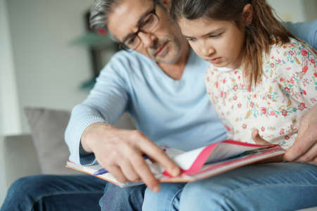 guiding: Man helping daughter with homework