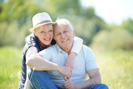 Senior couple relaxing in countryside