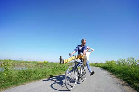 're: Cheerful couple riding bike on a sunny day