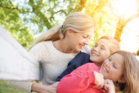 caucasian: Mother with kids having fun outside Stock Photo