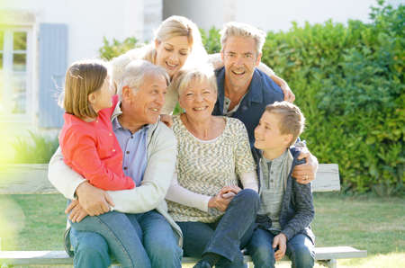 Portrait of intergenerational family sitting on bench Stock Photo