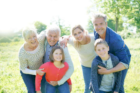 Intergenerational family walking together in park Stock Photo