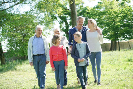 Happy intergenerational family walking in garden