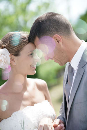 Profile view of bride and groom looking at each others eyes