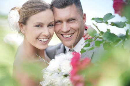 Portrait of smiling bride and groom