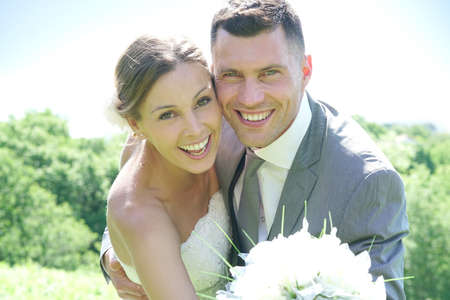 Portrait of cheerful bride and groom