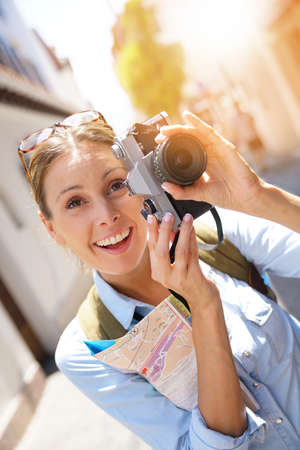 Portrait of tourist taking picture of architectural details Stock Photo