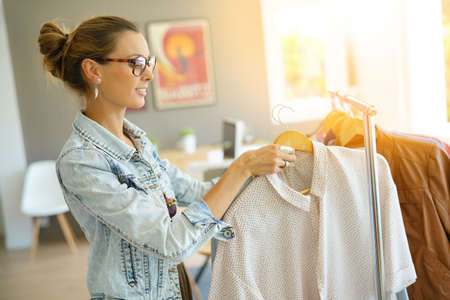 Cheerful Clothing Salesperson Standing In Shop Stock Photo, Picture ...
