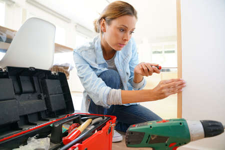 only adult: Woman doing DIY work at home