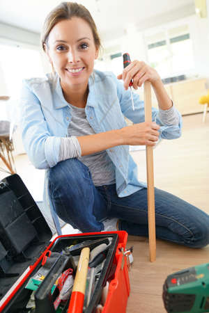 only adult: Portrait of woman doing DIY work at home