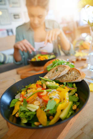 Closeup of veggie salad set on restaurant table