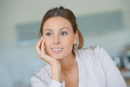 Portrait of beautiful woman relaxing at home
