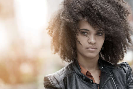 Portrait of mixed-raced girl in town