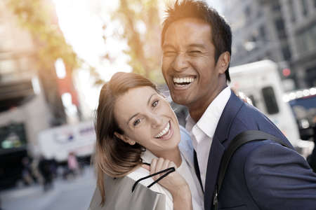 Cheerful couple doing shopping in New York city