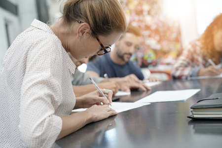 application university: University students filling in application form