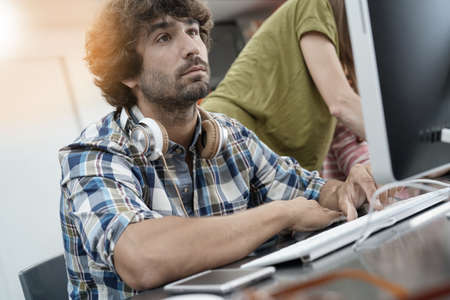 30 years old man: Startup entrepreneur working on desktop in office Stock Photo