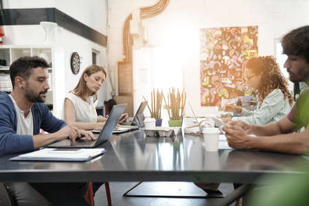 Trendy young people working in co-working office Stock Photo