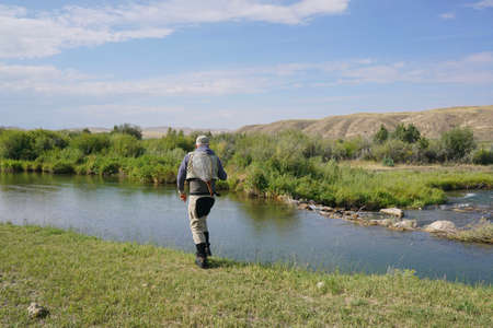 Fly fisherman fishing in river of Montana state Stock Photo