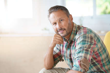 Mature man relaxing at home