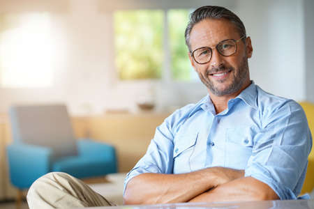 Portrait of handsome 45-year-old man with eyeglasses 스톡 콘텐츠
