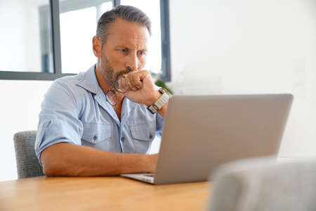 homeoffice: Man working on laptop at home