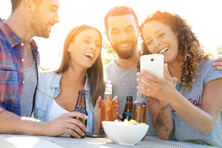 Group of friends having fun taking selfie pictures Banque d'images